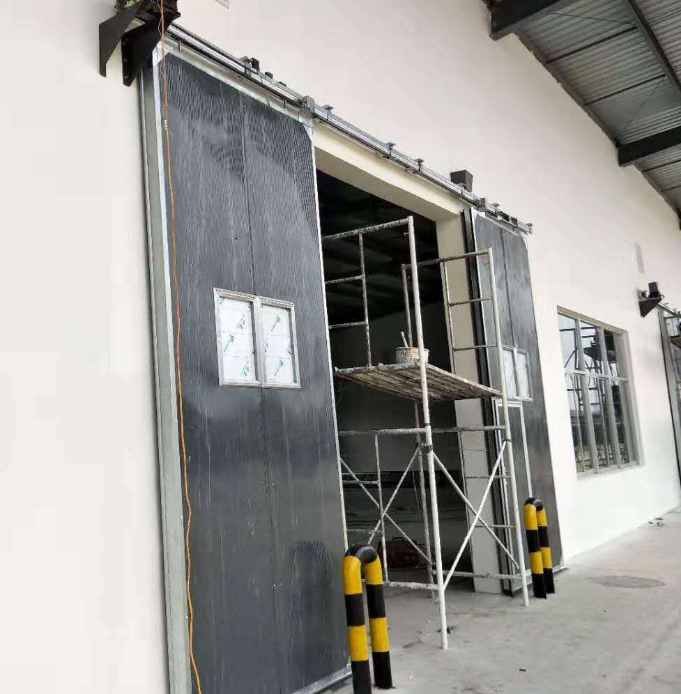 甘肃张掖保温平开门 保温平移门 保温折叠门 钢制大门 工业门厂家